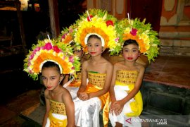 Balinese young girls possessed by Goddesses on mission to salvage traditions