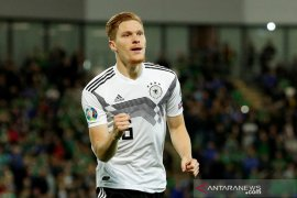 Kalahkan Irlandia Utara, Jerman puncaki Grup C