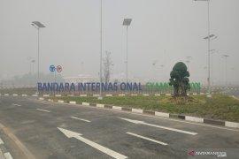 Jarak pandang Bandara Syamsudin Noor cuma 50 meter