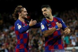 """Griezmann mengakui belum """"nyetel"""" dengan Lionel Messi dan Luis Suarez"""