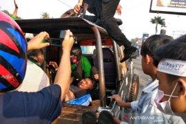 Unjuk rasa di Padangsidimpuan ricuh, polisi tembakkan gas air mata
