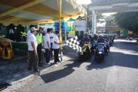 BPJS Ketenagakerjaan Ternate bagikan helm dalam kampanye keselamatan berkendaraan