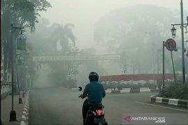 Hujan lebat belum berdampak usir kabut asap