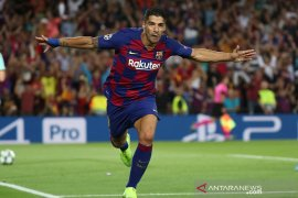 Suarez bantu Barcelona lumat Inter 2-1