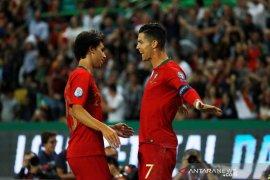 Cristiano Ronaldo berhasil mencetak gol ke-700