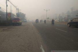 Kabut asap masih selimut Kota Banjarmasin
