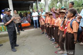 Bupati Asahan saluran bantuan bagi korban banjir Desa Lubuk Palas
