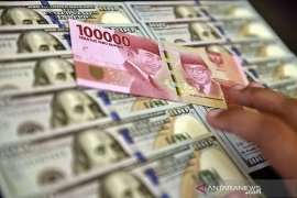 Rupiah forecasted to strengthen before year-end holidays