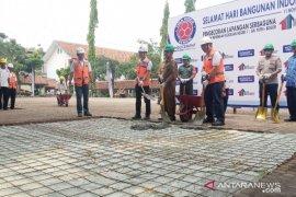 Hari Bangunan, Indocement merenovasi lapangan sekolah di Bogor
