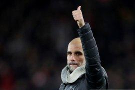 Pep Guardiola tegaskan masih senang di City