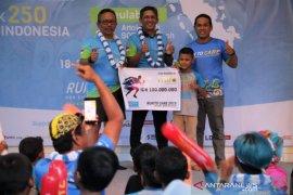 Mifa Bersaudara serahkan bantuan Rp100 juta untuk 250 anak Aceh di kegiatan Run To Care