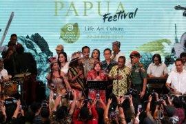 Festival Papua Page 1 Small