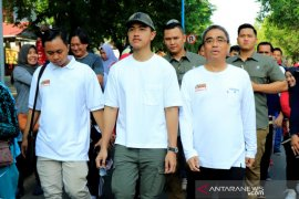 Youngest son of President walks in Murjani Square, Banjarbaru