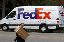 Saham FedEx turun tajam, Wall Street jeda reli pengaturan rekor
