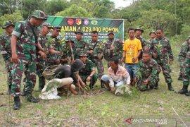 Kodim 1304 tanam bibit pohon di Lekabolo-Gorontalo