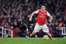 Mikel Arteta berhasil yakinkan Xhaka untuk bertahan di Arsenal
