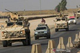 Amerika Serikat dan sekutu tunda pelatihan pasukan Irak