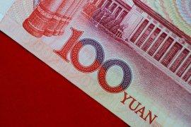 Yuan jatuh 530 basis poin menjadi 6,9779 terhadap dolar AS