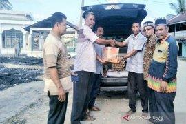 Asosiasi keuchik salurkan bantuan untuk korban kebakaran Pirak Timu