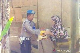 Polres Aceh Utara salurkan bantuan beras untuk 300 kaum duafa
