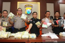 East Java police seize 15 kilograms of crystal meth smuggled from Malaysia