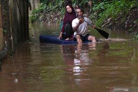 Jumat pagi, hujan masih membayangi wilayah Jakarta