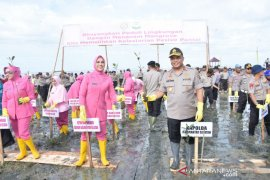 S Kalimantan police spread thousands of mangroves seeds at Pagatan Besar Beach