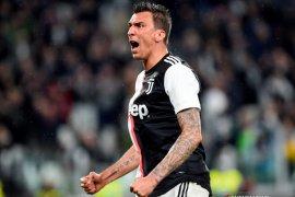 Mandzukic pikul beban patahkan kutukan nomor sembilan Milan
