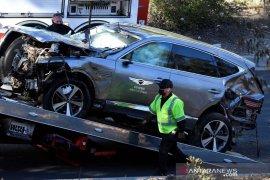 Tiger Woods tenga pulihkan diri usai operasi akibat kecelakaan mobil