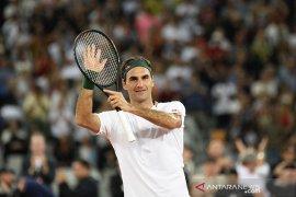 Roger Federer lelang barang koleksi dari karir Grand Slam