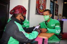 Teknologi Grab Tingkatkan Akses Layanan Keuangan di Perbatasan Indonesia