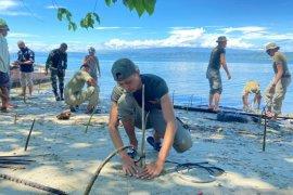 Satgas Madago Raya  tanam 1000 pohon bakau di pesisir laut Poso