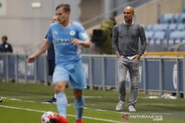 Pelatih Guardiola berharap pemain City bisa langsung berlatih tanpa karantina