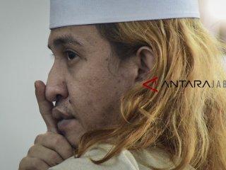 Terdakwa kasus dugaan penganiayaan terhadap remaja Bahar bin Smith menjalani sidang lanjutan di Gedung Perpustakaan dan Kearsipan Kota Bandung, Jawa Barat, Kamis (14/3/2019). Sidang lanjutan tersebut mengagendakan membacakan tanggapan tertulis dari Jaksa Penuntut umum atas eksepsi dari tim Kuasa Hukum Terdakwa. ANTARA JABAR/Raisan Al Farisi/agr.