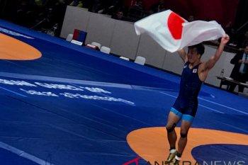 Pegulat Ota Shinobu persembahkan emas pertama Jepang