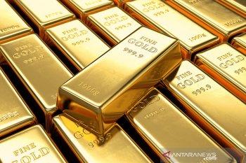 Emas turun tajam setelah ekuitas melonjak dan dolar AS menguat