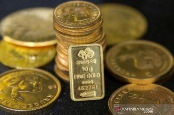 Emas berjangka pangkas keuntungan awal, berakhir sedikit lebih rendah