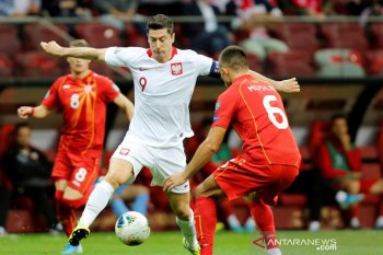 Polandia lolos ke putaran final setelah bungkam Makedonia Utara