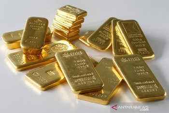Harga emas turun setelah saham pulih, dolar menguat jelang pertemuan Fed