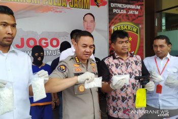 East Java police arrest two armed drug dealers