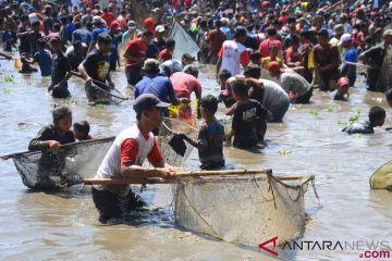 Tradisi Memet Ikan