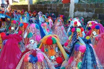 Tradisi perayaan Hari Rayo Enam di pekuburan