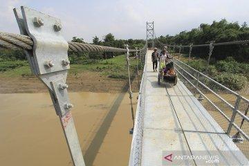 Target pembangunan jembatan gantung