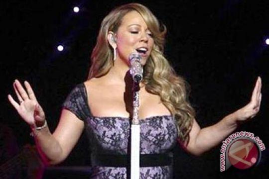 Lagu Natal Mariah Carey terjual sejuta kopi