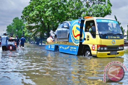 Perusahaan asuransi data klaim banjir Jakarta yang terjadi 25 Februari
