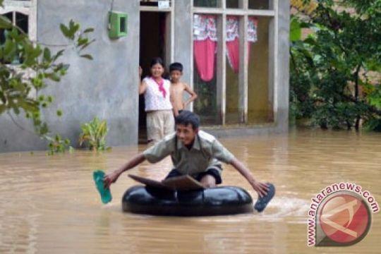 Sungai meluap  rendam perumahan warga Tulangbawang Lampung