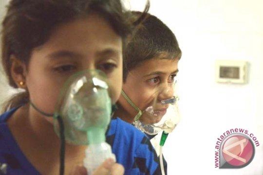 Media pemerintah Suriah: gerilyawan tembaki desa dengan gas