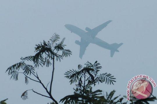 Puluhan penerbangan terganggu akibat kabut asap