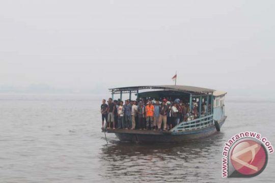 Puncak arus balik melalui Sungai Barito Minggu