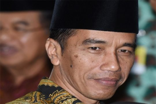 Presiden Jokowi berbusana Dayak naiki KMC Komando